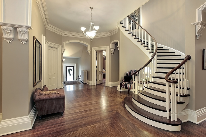 Foyer in traditional suburban home with curved staircase